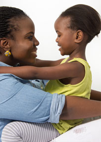 Happy African American mother playing with daughter