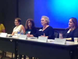 Photo of head table with speakers Dawn Smith, Debbie Gold, Georgia Lord, and Eileen Shuman.